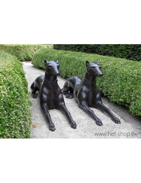 Paar liggende honden - bronzen beeld